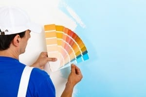 painter man looking a color palette
