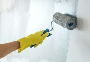 Hand painting wall in grey
