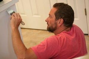 Man Painting Kitchen Cabinet
