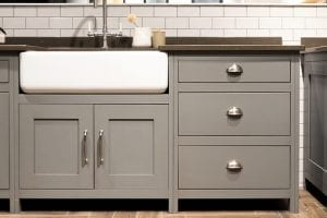 Gray painted kitchen cabinets with white sink